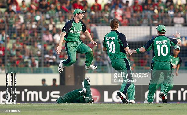 Andrew White of Ireland hurdles Roqibul Hassan of Bangladesh after running him out at ShereeBangla National Stadium on February 25 2011 in Dhaka...