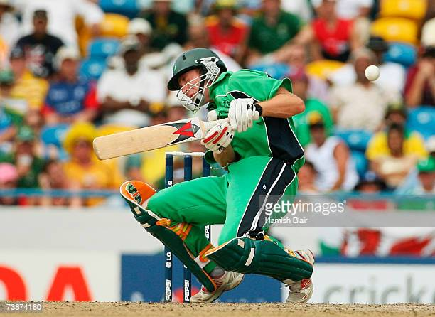 Andrew White of Ireland is hit by a delivery from Glenn McGrath of Australia during the ICC Cricket World Cup Super Eights match between Australia...