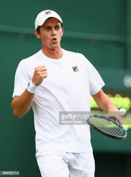 Andrew Whittington of Australia celebrates during the Gentlemen's Singles first round match on day one of the Wimbledon Lawn Tennis Championships at...