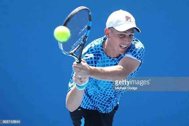 Andrew Whittington of Australia plays a backhand in his first round doubles match against Gilles Muller of Luxembourg and Mahesh Bhupathi of India...