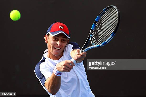 Andrew Whittington of Australia plays a backhand in his second round match against ivo karlovic of Croatia on day four of the 2017 Australian Open at...