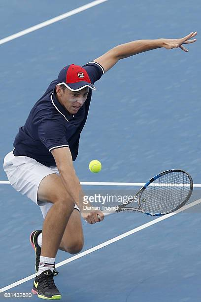 Andrew Whittington of Australia plays a backhand shot in his match against Mikhail Youzhny of Russia during day two of the 2017 Priceline Pharmacy...