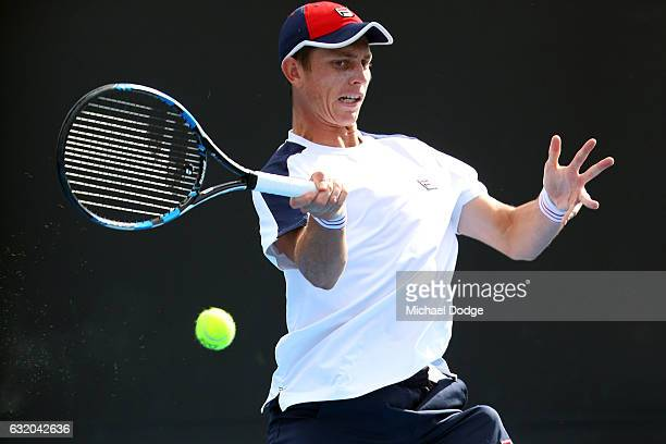 Andrew Whittington of Australia plays a forehand in his second round match against ivo karlovic of Croatia on day four of the 2017 Australian Open at...