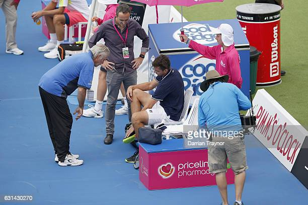 Andrew Whittington of Australia takes a mediacal time out in his match against Mikhail Youzhny of Russia during day two of the 2017 Priceline...