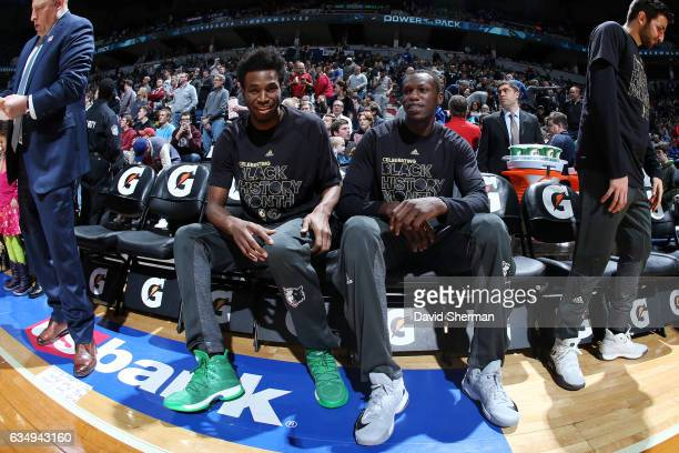 Andrew Wiggins and Gorgui Dieng of the Minnesota Timberwolves wait for introductions before the game against the Chicago Bulls on February 12 2017 at...