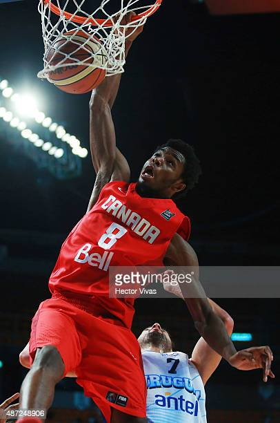 Andrew Wiggins of Canada dunks the ball against Mathias Calfani of Uruguay during a second stage match between Uruguay and Canada as part of the 2015...