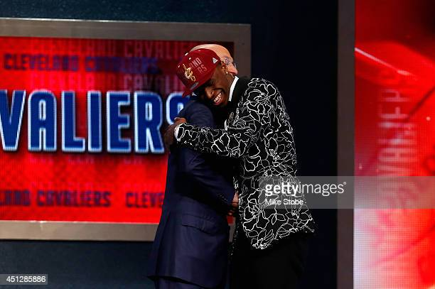 Andrew Wiggins of Kansas embraces NBA Commissioner Adam Silver after Wiggins was drafted overall in the first round by the Cleveland Cavaliers during...