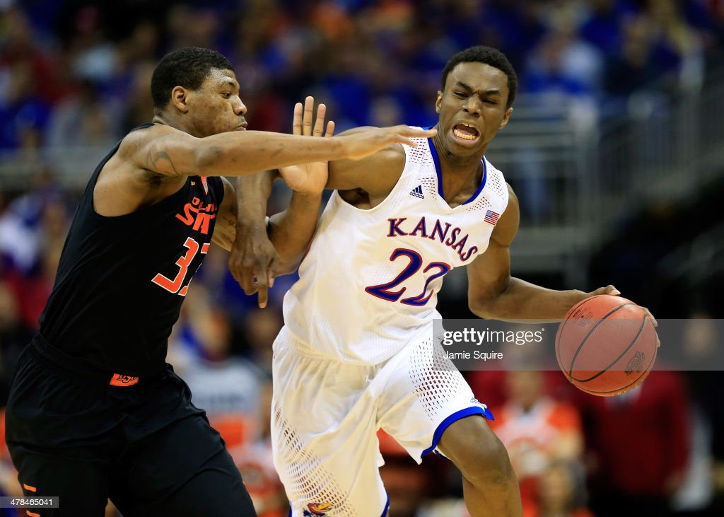 <a gi-track='captionPersonalityLinkClicked' href=/galleries/search?phrase=Andrew+Wiggins&family=editorial&specificpeople=7720937 ng-click='$event.stopPropagation()'>Andrew Wiggins</a> #22 of the Kansas Jayhawks drives upcourt as <a gi-track='captionPersonalityLinkClicked' href=/galleries/search?phrase=Marcus+Smart&family=editorial&specificpeople=7887125 ng-click='$event.stopPropagation()'>Marcus Smart</a> #33 of the Oklahoma State Cowboys defends during the Big 12 Basketball Tournament quarterfinal game at Sprint Center on March 13, 2014 in Kansas City, Missouri.