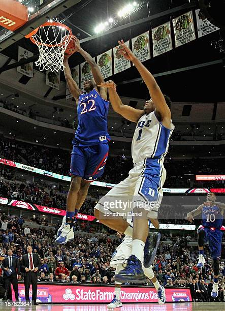 Andrew Wiggins of the Kansas Jayhawks dunks over Jabari Parker of the Duke Blue Devils during the State Farm Champions Classic at the United Center...