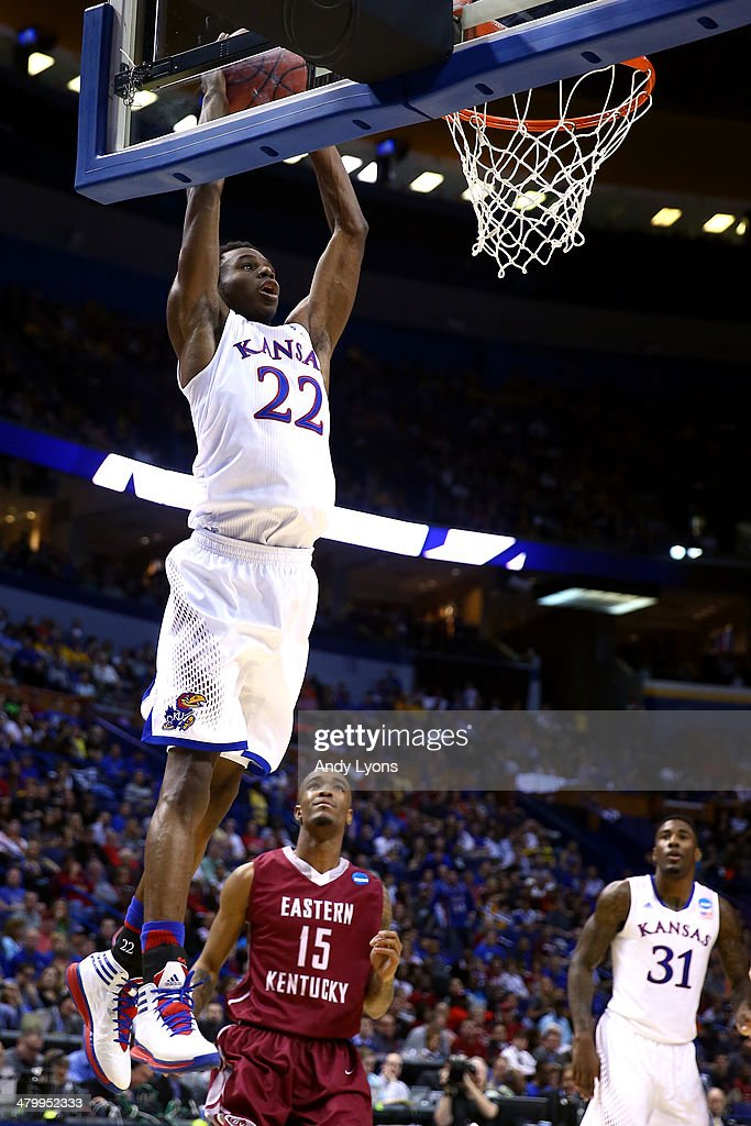 <a gi-track='captionPersonalityLinkClicked' href=/galleries/search?phrase=Andrew+Wiggins&family=editorial&specificpeople=7720937 ng-click='$event.stopPropagation()'>Andrew Wiggins</a> #22 of the Kansas Jayhawks dunks the ball against the Eastern Kentucky Colonels during the second round of the 2014 NCAA Men's Basketball Tournament at Scottrade Center on March 21, 2014 in St Louis, Missouri.