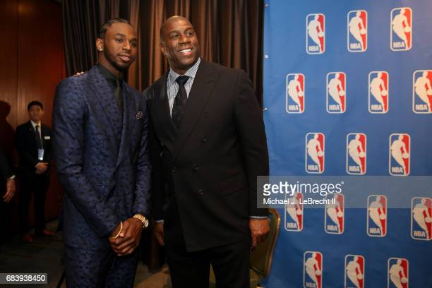 Andrew Wiggins of the Minnesota Timberwolves and Magic Johnson smile during the 2017 NBA Draft Lottery at the New York Hilton in New York New York...