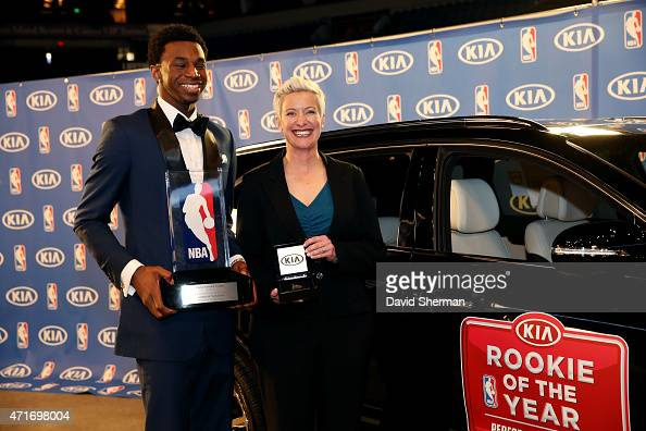 Andrew Wiggins of the Minnesota Timberwolves and Stephanie Janiunas Regional Marketing Manager Kia Motors American pose for a picture when is...