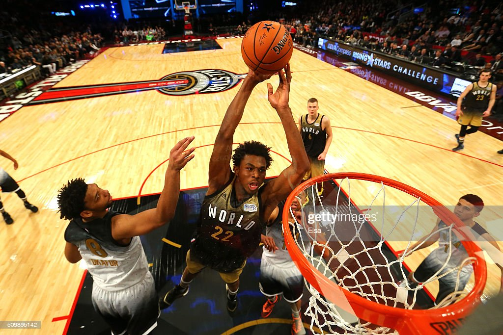 Andrew Wiggins #22 of the Minnesota Timberwolves and World team goes up for a dunk in the second half against Jahlil Okafor #8 of the Philadelphia Sixers and the United States team during the BBVA Compass Rising Stars Challenge 2016 at Air Canada Centre on February 12, 2016 in Toronto, Canada.