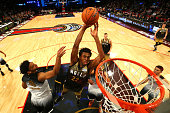 Andrew Wiggins of the Minnesota Timberwolves and World team goes up for a dunk in the second half against Jahlil Okafor of the Philadelphia Sixers...