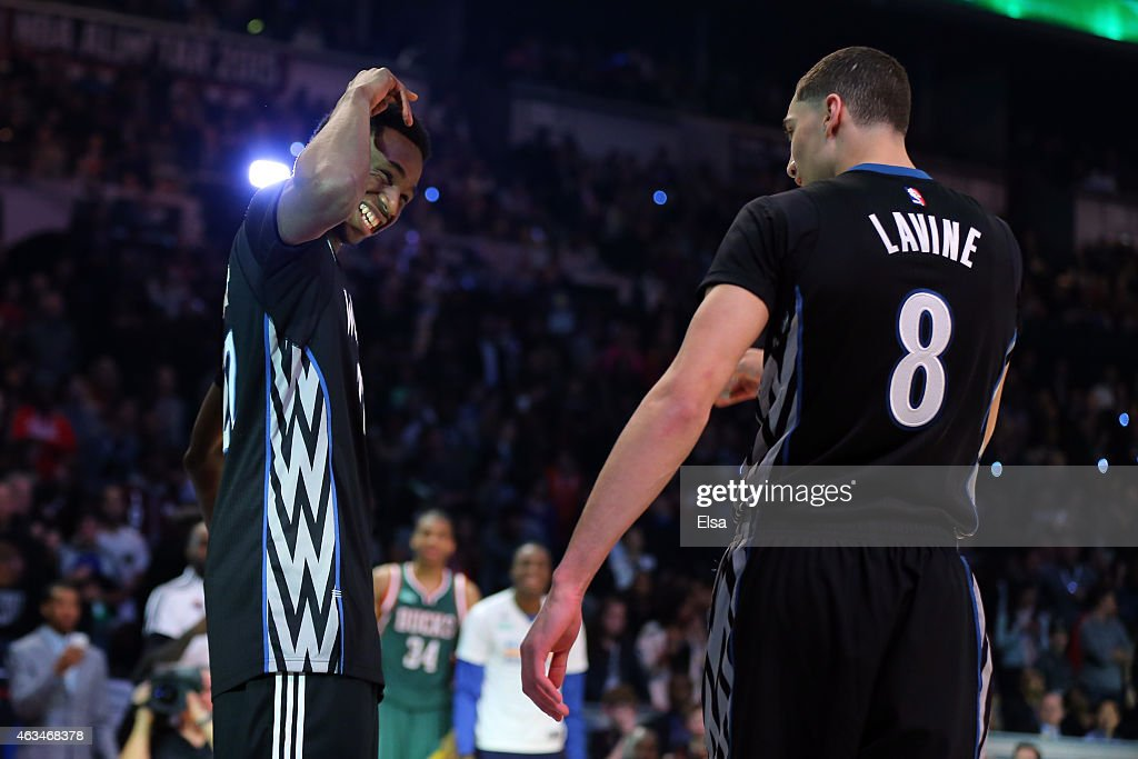 <a gi-track='captionPersonalityLinkClicked' href=/galleries/search?phrase=Andrew+Wiggins&family=editorial&specificpeople=7720937 ng-click='$event.stopPropagation()'>Andrew Wiggins</a> #22 of the Minnesota Timberwolves celebrates after a dunk by <a gi-track='captionPersonalityLinkClicked' href=/galleries/search?phrase=Zach+LaVine&family=editorial&specificpeople=11631430 ng-click='$event.stopPropagation()'>Zach LaVine</a> #8 of the Minnesota Timberwolves during the Sprite Slam Dunk Contest as part of the 2015 NBA Allstar Weekend at Barclays Center on February 14, 2015 in the Brooklyn borough of New York City.