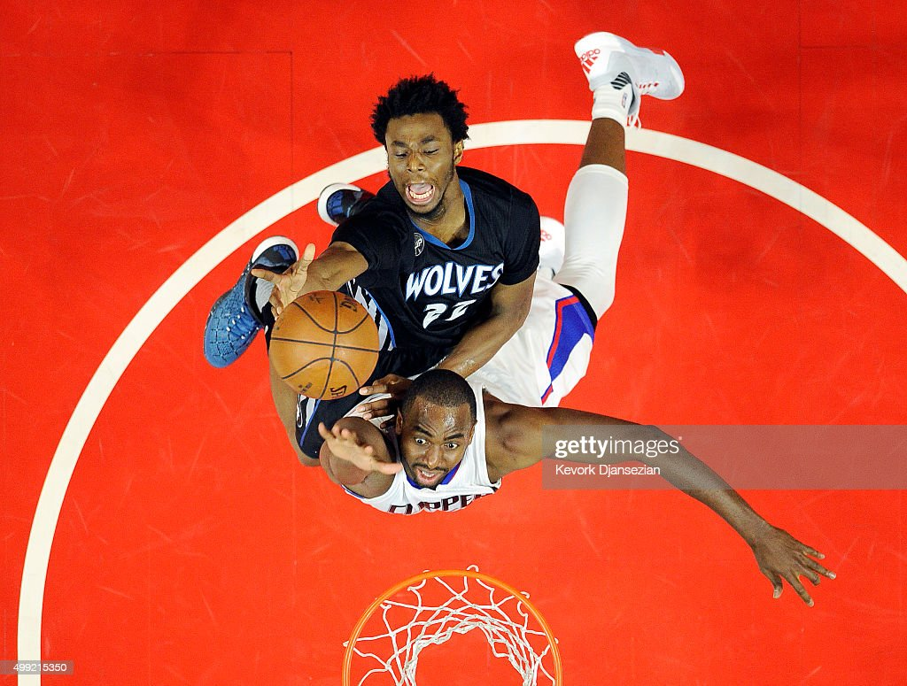 <a gi-track='captionPersonalityLinkClicked' href=/galleries/search?phrase=Andrew+Wiggins&family=editorial&specificpeople=7720937 ng-click='$event.stopPropagation()'>Andrew Wiggins</a> #22 of the Minnesota Timberwolves drives to the basket over <a gi-track='captionPersonalityLinkClicked' href=/galleries/search?phrase=Luc+Richard+Mbah+a+Moute&family=editorial&specificpeople=699041 ng-click='$event.stopPropagation()'>Luc Richard Mbah a Moute</a> #12 of the Los Angeles Clippers during the second half of the basketball game at Staples Center November 29, 2015, in Los Angeles, California.