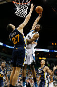 Andrew Wiggins of the Minnesota Timberwolves dunks against Rudy Gobert of the Utah Jazz during the game on March 30 2015 at Target Center in...
