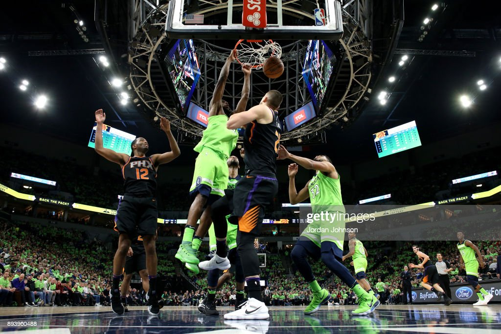 Andrew Wiggins #22 of the Minnesota Timberwolves dunks against the Phoenix Suns on December 16, 2017 at Target Center in Minneapolis, Minnesota.