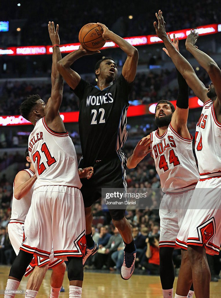 <a gi-track='captionPersonalityLinkClicked' href=/galleries/search?phrase=Andrew+Wiggins&family=editorial&specificpeople=7720937 ng-click='$event.stopPropagation()'>Andrew Wiggins</a> #22 of the Minnesota Timberwolves goes up for a shot over (L-R) <a gi-track='captionPersonalityLinkClicked' href=/galleries/search?phrase=Jimmy+Butler+-+Basketball+Player&family=editorial&specificpeople=9860567 ng-click='$event.stopPropagation()'>Jimmy Butler</a> #21, Nikola Mirotic #44 and <a gi-track='captionPersonalityLinkClicked' href=/galleries/search?phrase=Nazr+Mohammed&family=editorial&specificpeople=201690 ng-click='$event.stopPropagation()'>Nazr Mohammed</a> #48 of the Chicago Bulls at the United Center on February 27, 2015 in Chicago, Illinois.