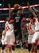 Andrew Wiggins of the Minnesota Timberwolves goes up for a shot over Jimmy Butler Nikola Mirotic and Nazr Mohammed of the Chicago Bulls at the United...