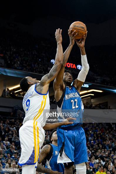 Andrew Wiggins of the Minnesota Timberwolves grabs a defensive rebound against Andre Iguodala of the Golden State Warriors during the game on...