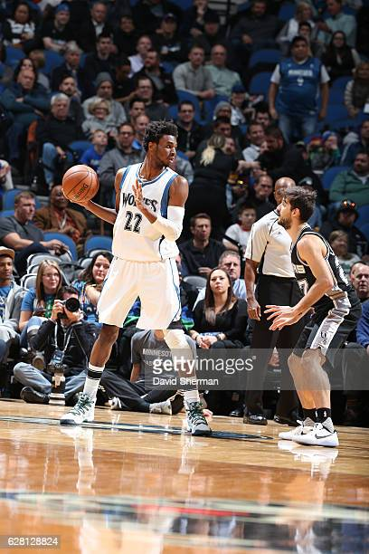 Andrew Wiggins of the Minnesota Timberwolves handles the ball against Nicolas Laprovittola of the San Antonio Spurs during a game on December 6 2016...