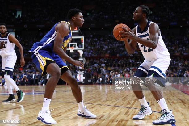 Andrew Wiggins of the Minnesota Timberwolves in action against Damian Jones of the Golden State Warriors during the game between the Minnesota...