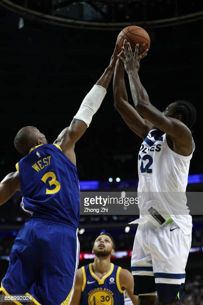 Andrew Wiggins of the Minnesota Timberwolves in action against David West of the Golden State Warriors during the game between the Minnesota...