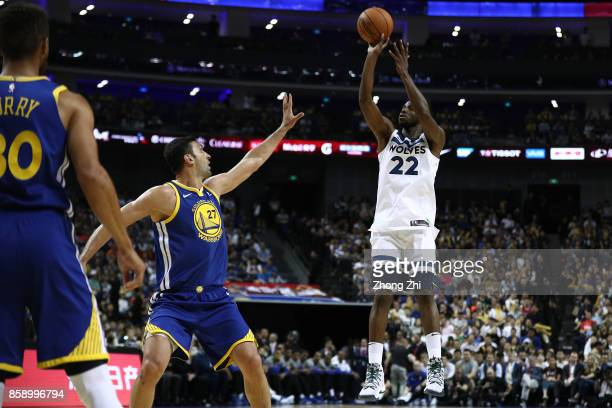 Andrew Wiggins of the Minnesota Timberwolves in action against Zaza Pachulia of the Golden State Warriors during the game between the Minnesota...