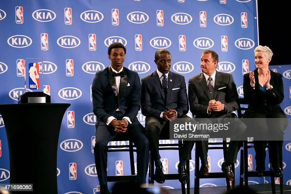 Andrew Wiggins of the Minnesota Timberwolves is presented with the 2014 2015 Kia NBA Rookie of the Year Award by Timberwolves President of Basketball...