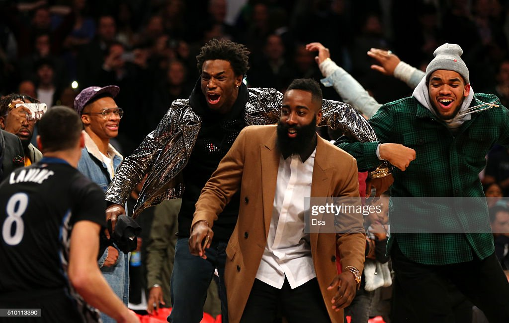 <a gi-track='captionPersonalityLinkClicked' href=/galleries/search?phrase=Andrew+Wiggins&family=editorial&specificpeople=7720937 ng-click='$event.stopPropagation()'>Andrew Wiggins</a> of the Minnesota Timberwolves, <a gi-track='captionPersonalityLinkClicked' href=/galleries/search?phrase=James+Harden&family=editorial&specificpeople=4215938 ng-click='$event.stopPropagation()'>James Harden</a> of the Houston Rockets and Karl-Anthony Towns of the Minnesota Timberwolves react after a <a gi-track='captionPersonalityLinkClicked' href=/galleries/search?phrase=Zach+LaVine&family=editorial&specificpeople=11631430 ng-click='$event.stopPropagation()'>Zach LaVine</a> of the Minnesota Timberwolves dunk in the Verizon Slam Dunk Contest during NBA All-Star Weekend 2016 at Air Canada Centre on February 13, 2016 in Toronto, Canada.