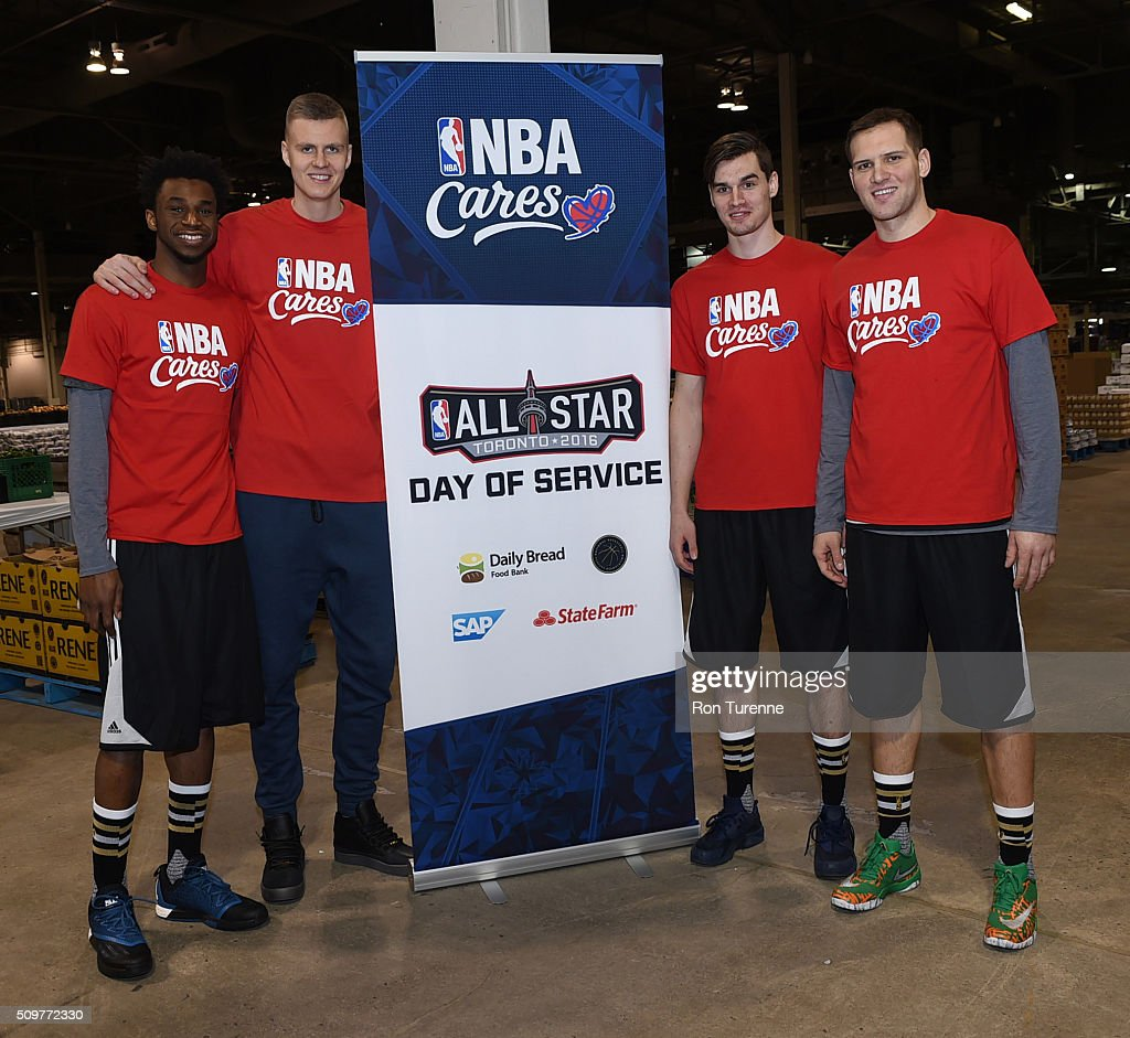 Andrew Wiggins of the Minnesota Timberwolves, Kristaps Porzingis of the New York Knicks, Mario Hezonja of the Orlando Magic and Bojan Bogdanovic of the Brooklyn Nets pose for a photo during the NBA Cares All-Star Day of Service as part of 2016 All-Star Weekend at NBA Centre Court of the Enercare Centre on February 12, 2016 in Toronto, Ontario, Canada.