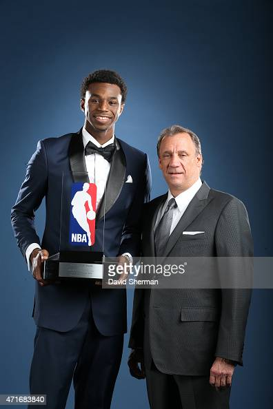 Andrew Wiggins of the Minnesota Timberwolves poses with the Eddie Gottlieb trophy as he is named the 2014 2015 Kia NBA Rookie of the Year Award by...