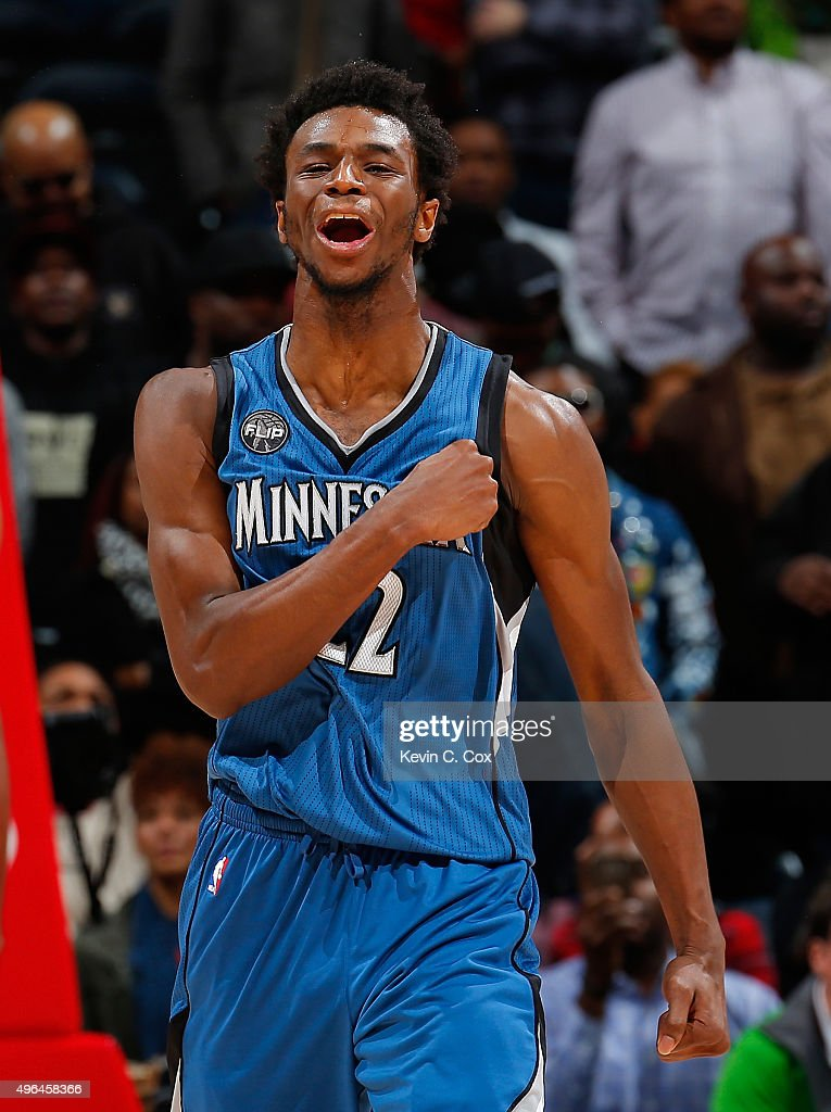 <a gi-track='captionPersonalityLinkClicked' href=/galleries/search?phrase=Andrew+Wiggins&family=editorial&specificpeople=7720937 ng-click='$event.stopPropagation()'>Andrew Wiggins</a> #22 of the Minnesota Timberwolves reacts after drawing a foul on a basket against the Atlanta Hawks at Philips Arena on November 9, 2015 in Atlanta, Georgia. NOTE TO USER User expressly acknowledges and agrees that, by downloading and or using this photograph, user is consenting to the terms and conditions of the Getty Images License Agreement.