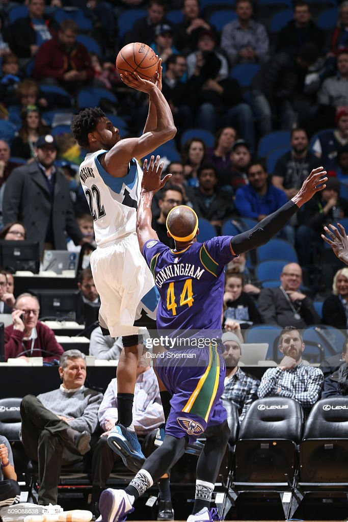 <a gi-track='captionPersonalityLinkClicked' href=/galleries/search?phrase=Andrew+Wiggins&family=editorial&specificpeople=7720937 ng-click='$event.stopPropagation()'>Andrew Wiggins</a> #22 of the Minnesota Timberwolves shoots against <a gi-track='captionPersonalityLinkClicked' href=/galleries/search?phrase=Dante+Cunningham&family=editorial&specificpeople=683729 ng-click='$event.stopPropagation()'>Dante Cunningham</a> #44 of the New Orleans Pelicans during the game on February 8, 2016 at Target Center in Minneapolis, Minnesota.