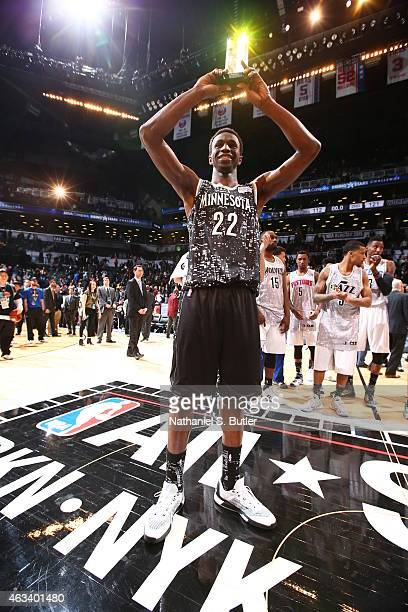 Andrew Wiggins of the World Team is awarded the BBVA Compass Rising Stars MVP trophy after playing a game against the US Team during the BBVA Compass...