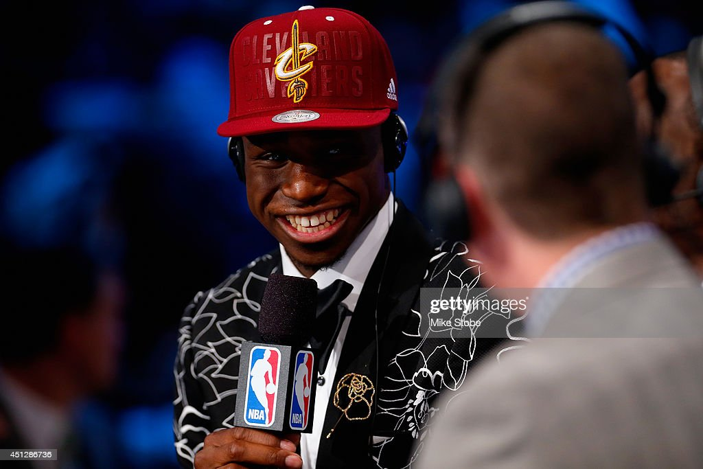 <a gi-track='captionPersonalityLinkClicked' href=/galleries/search?phrase=Andrew+Wiggins&family=editorial&specificpeople=7720937 ng-click='$event.stopPropagation()'>Andrew Wiggins</a> smiles during an interview after being drafted #1 overall in the first round by the Cleveland Cavaliers during the 2014 NBA Draft at Barclays Center on June 26, 2014 in the Brooklyn borough of New York City.