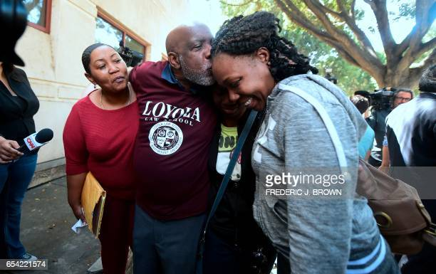 Andrew Wilson celebrates his freedom after stepping out of the Men's Central Jail in Los Angeles California on March 16 kissing his daughter Latrina...