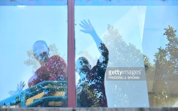 Andrew Wilson waves as he descends another flight of stairs to his release from the Men's Central Jail in Los Angeles California on March 16...
