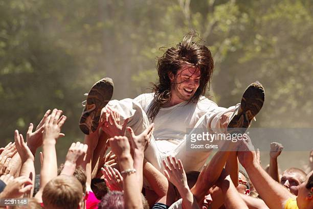 Andrew WK rides the crowd while performing on the first US day of Ozzfest 2002 at Montage Mountain in Scranton Pennsylvania 7/10/02 Photo by Scott...