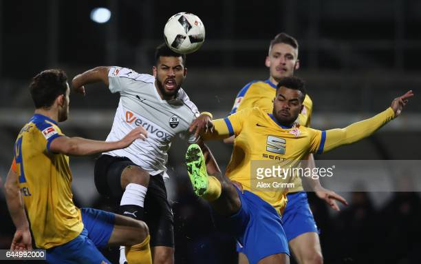 Andrew Wooten of Sandhausen is challenged by Ken Reichel and Phil OfosuAyeh of Braunschweig during the Second Bundesliga match between SV Sandhausen...