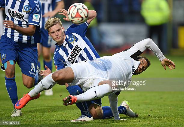 Andrew Wooten of Sandhausen is challenged by Philipp Max of Karlsruhe during the Second Bundesliga match between SV Sandhausen and Karlsruher SC at...
