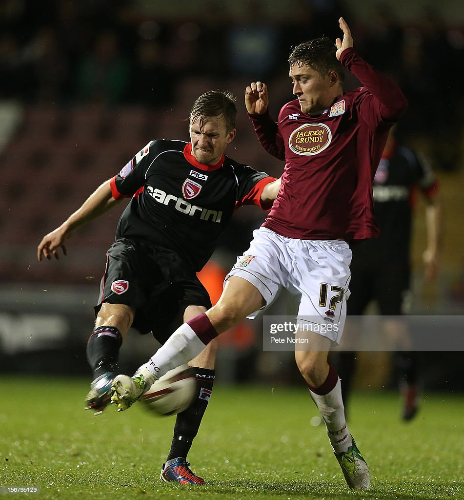 Andrew Wright of Morecambe plays the ball under pressure from Jake Robinson of Northampton Town during the npower League Two match between Northampton Town and Morecambe at Sixfields Stadium on November 20, 2012 in Northampton, England.
