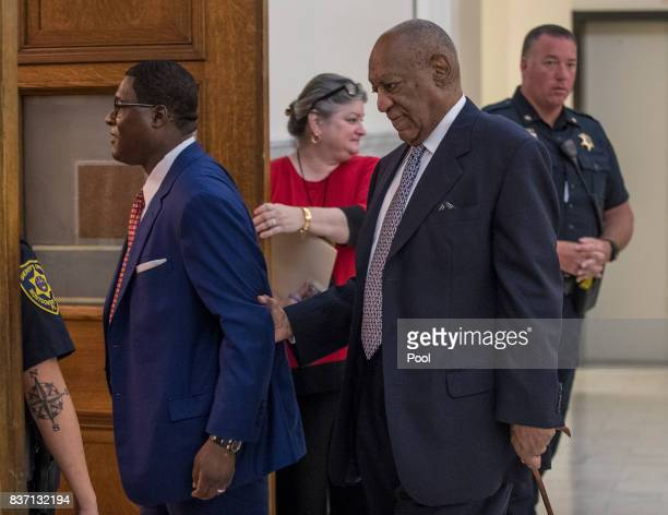 Andrew Wyatt left guides Bill Cosby center into Courtroom A at the Montgomery County Courthouse August 22 2017 in Norristown Pennsylvania Bill Cosby...