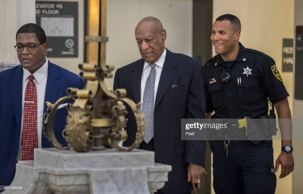 Andrew Wyatt, left, leads Bill Cosby, center, toward Courtroom A at the Montgomery County Courthouse August 22, 2017 in Norristown, Pennsylvania. Bill Cosby and his new lawyers will have a hearing in Montgomery County Court about dropping his old counsel, adding his new counsel and if the jury pool will be taken out of county again.