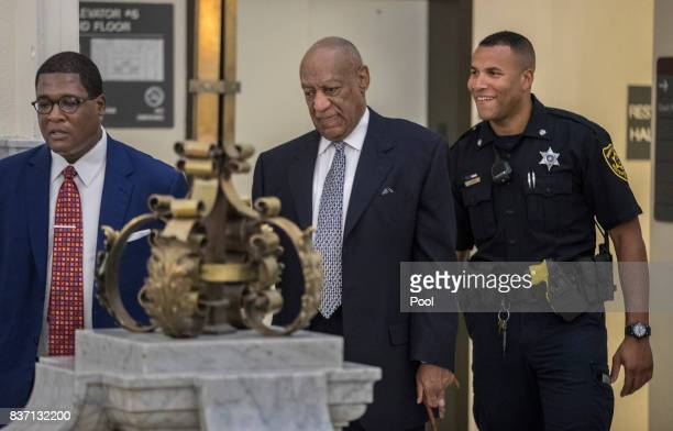 Andrew Wyatt left leads Bill Cosby center toward Courtroom A at the Montgomery County Courthouse August 22 2017 in Norristown Pennsylvania Bill Cosby...