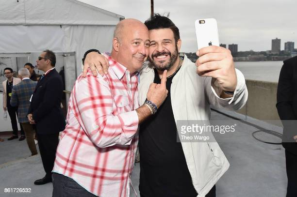 Andrew Zimmern and Adam Richman attend the Food Network Cooking Channel New York City Wine Food Festival Presented By CocaCola CocaCola Backyard BBQ...