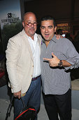 Andrew Zimmern and Buddy Valastro attend Amstel Light Burger Bash Presented By Schweid Sons Hosted By Rachael Ray during 2016 Food Network Cooking...
