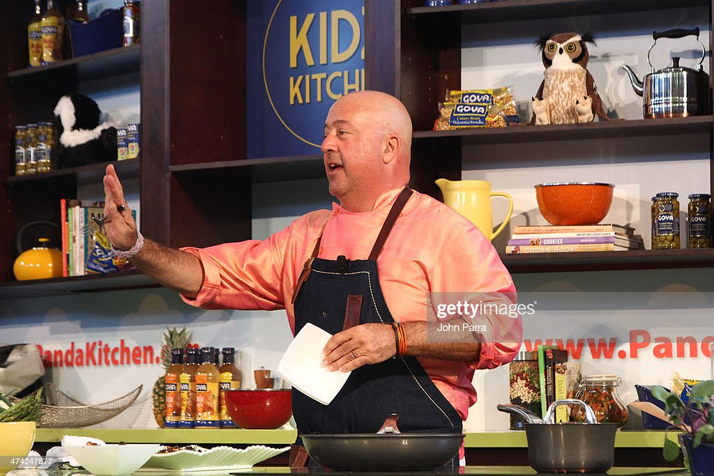 <a gi-track='captionPersonalityLinkClicked' href=/galleries/search?phrase=Andrew+Zimmern&family=editorial&specificpeople=4525179 ng-click='$event.stopPropagation()'>Andrew Zimmern</a> gives a cooking demonstration during Fun And Fit As A Family Sponsored By Carnival Featuring Goya Kidz Kitchen Hosted By Robert Irvine during the Food Network South Beach Wine & Food Festival at Jungle Island on February 22, 2014 in Miami, Florida.