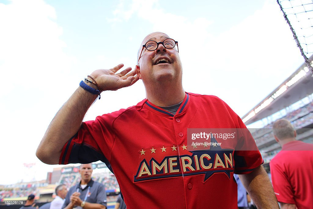 Andrew Zimmern listens to a fan before the 2014 MLB All-Star legends and celebrity softball game on July 13, 2014 at the Target Field in Minneapolis, Minnesota.